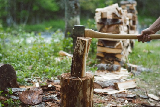 an image of a person splitting wood